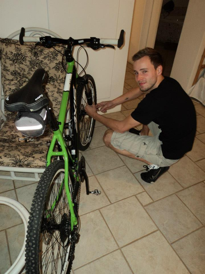 Here he is attaching all his new gadgets to his bike, so chuffed with everything