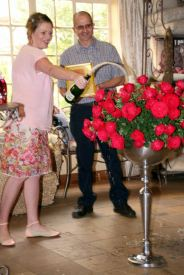Christening the roses with champagne...